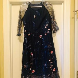 Navy blue dress with floral mesh overlay